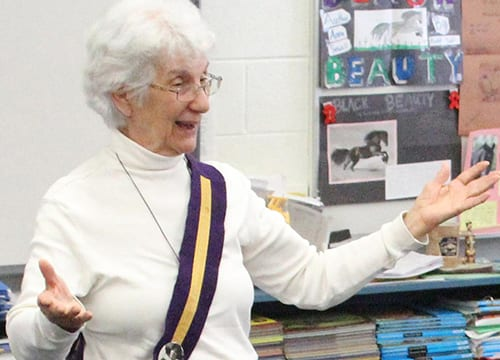 Former Lower School Librarian Discusses Alice Paul, Women's Suffrage, and Peace Issues with Fourth Grade