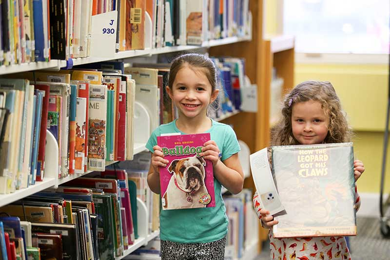 Photo Gallery – Kindergarten Checking Out Library Books