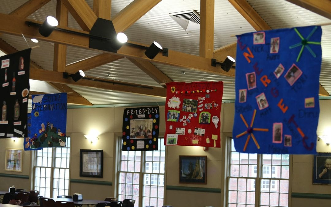 Middle School Advisory Classes Decorate Dining Hall Commons with Community Banners